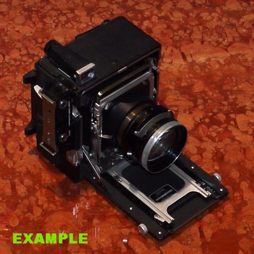 Realizzazione raccordo fotocamera per microscopio Ø29 con fuoco su piano battuta